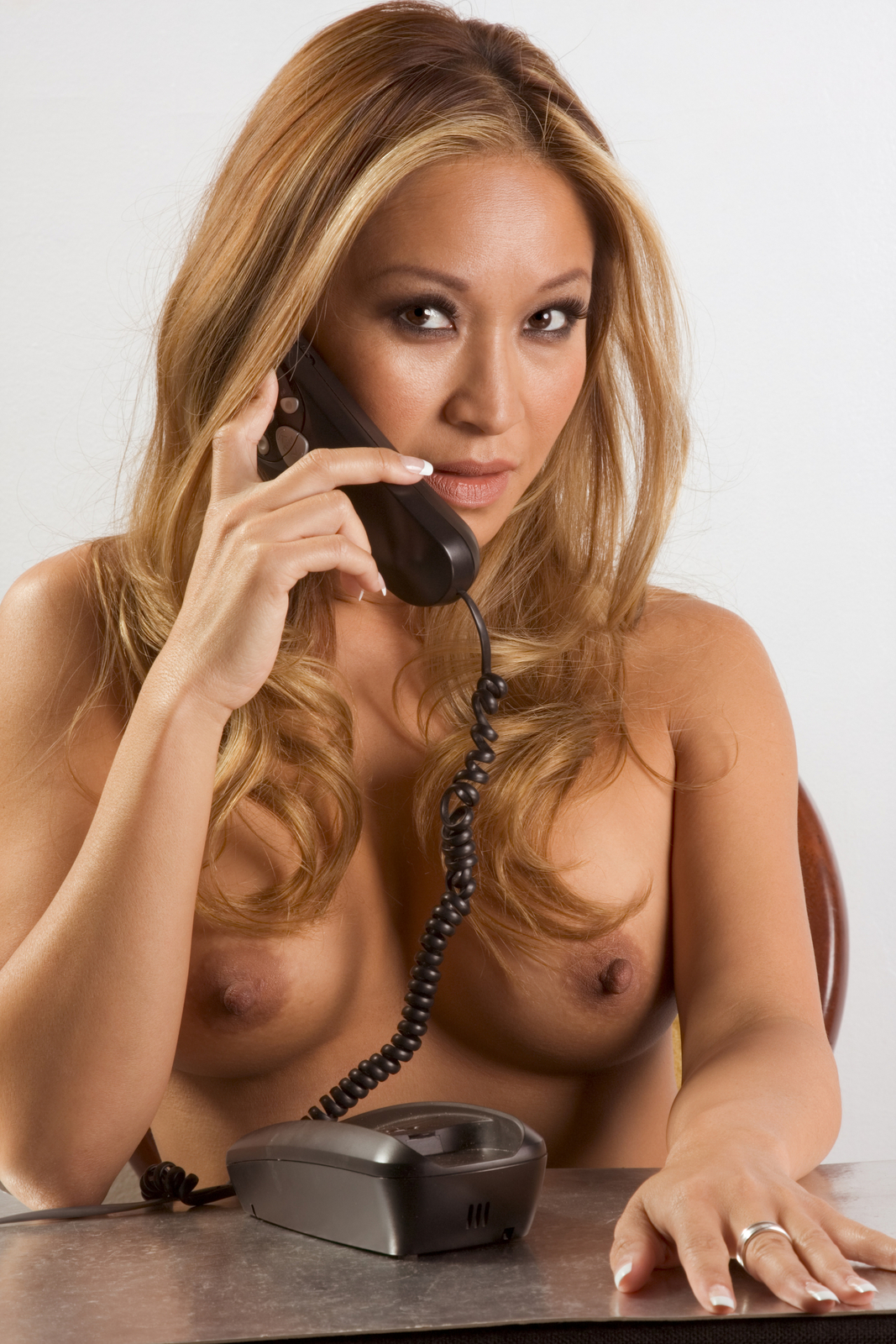 Sexy topless woman talking on the phone