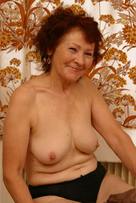 Old lady Edith goes topless, showing her sexy granny tits off.