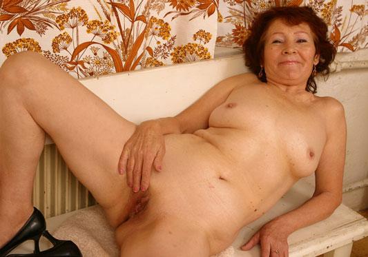 Granny naked, spreading her legs