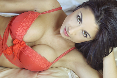 dark haired girl with massive tits in an orange bra