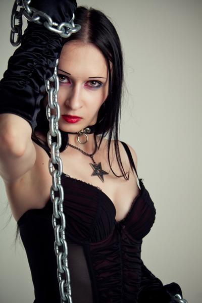 Goth dominatrix with a chain