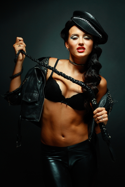 dominatrix in leather with a rope whip