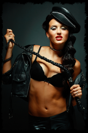 hardcore dominatrix dressed in leather with a whip